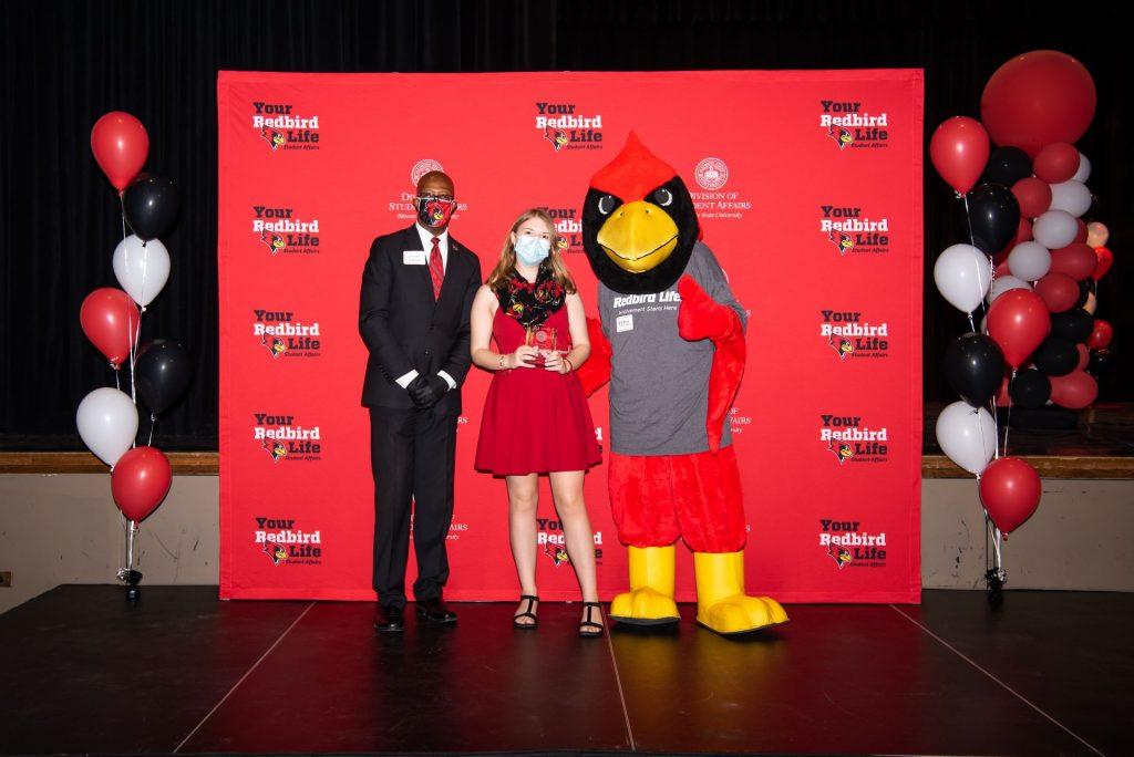 Jennifer Miller, Levester Johnson, and Reggie posing at the Student Involvement Awards