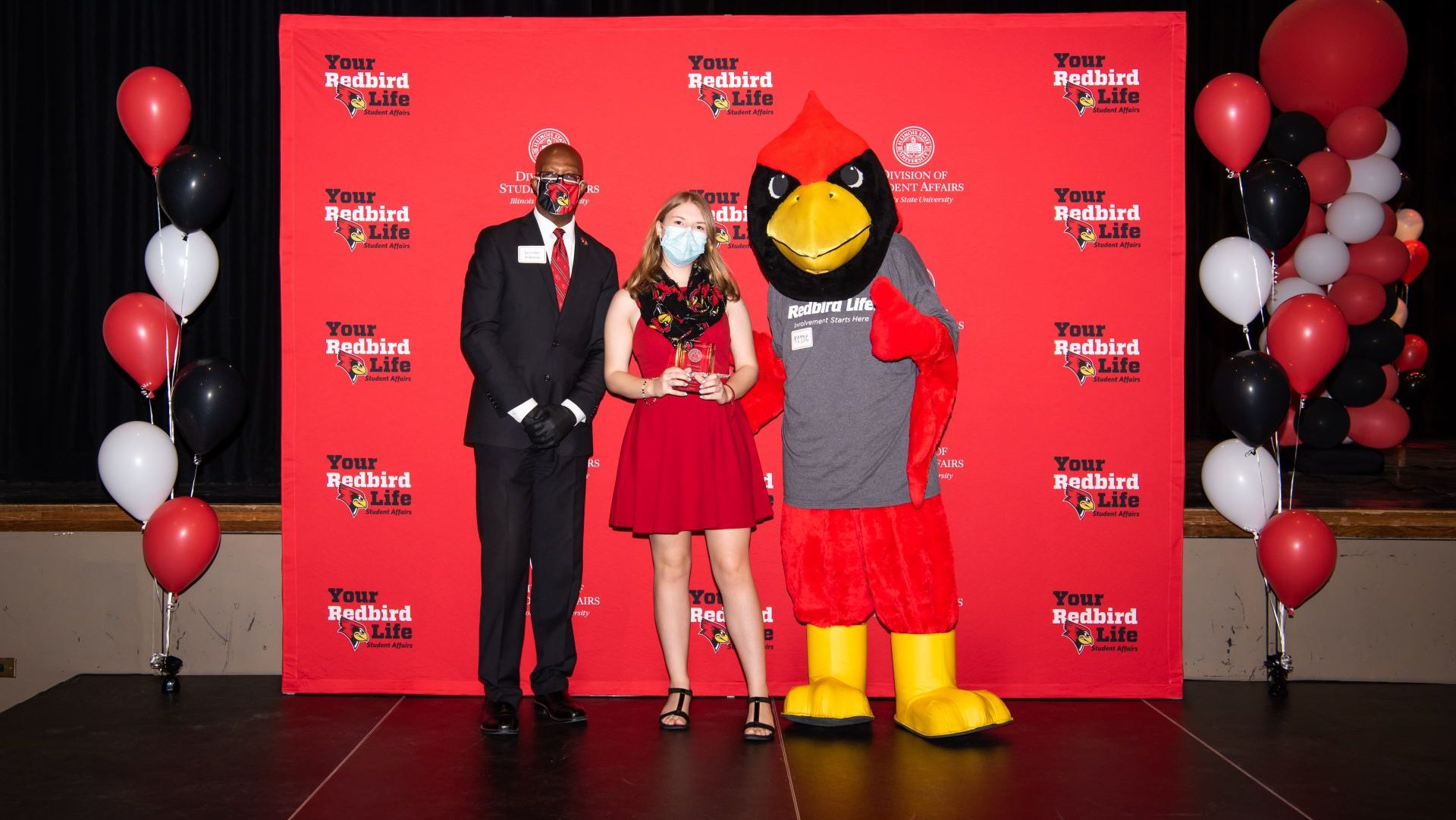 Jennifer Miller with Levester Johnson and Reggie Redbird at the Student Involvement Awards