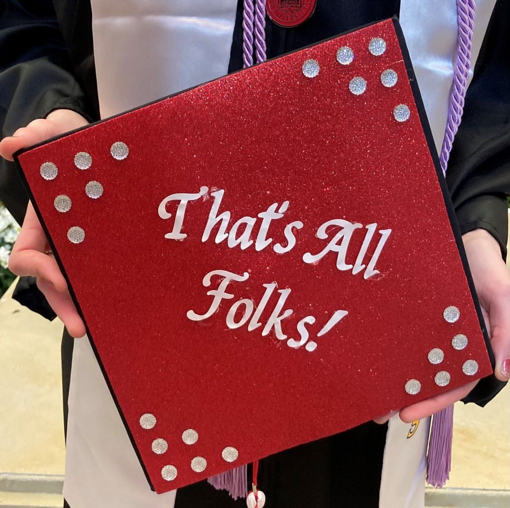 """Grad cap with """"That's All Folks!"""" on it."""