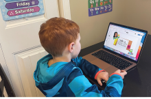 First grade student Layton L. works on an E-tutoring lesson.