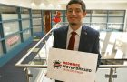 SGA president holding Redbirds Move Forward vaccine sign