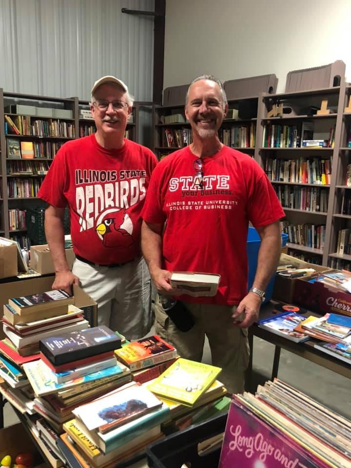 Two men holding books