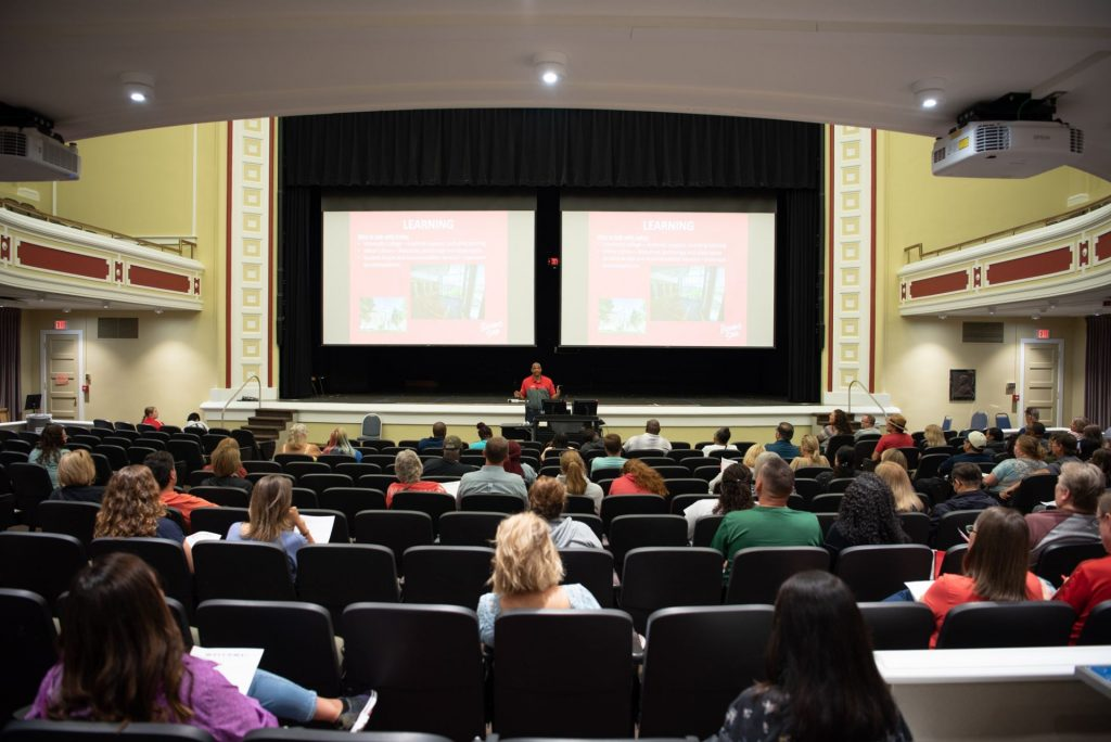 Dean John Davenport welcomes the families to campus during the morning parent and family session.