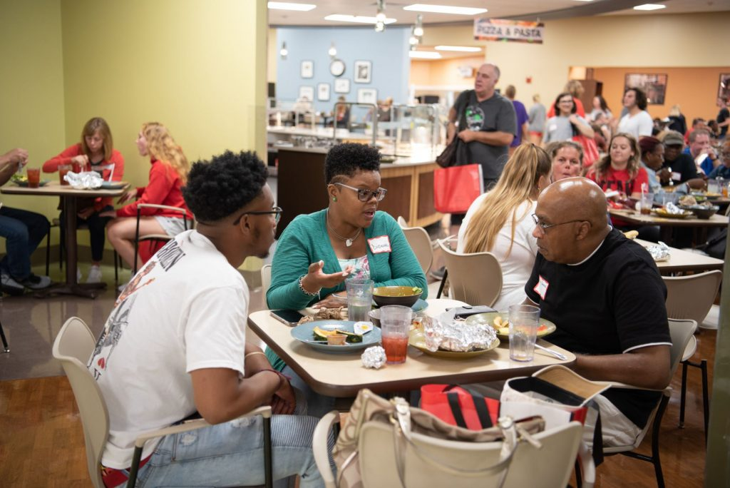 Students and families enjoy a free lunch at Watterson Dining Commons