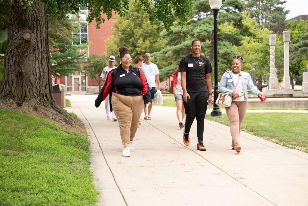 Preview Guide Raven Grier Bain takes a student and his family on a tour of the Quad.