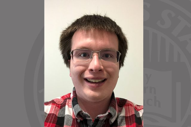 Portrait of student with ISU background