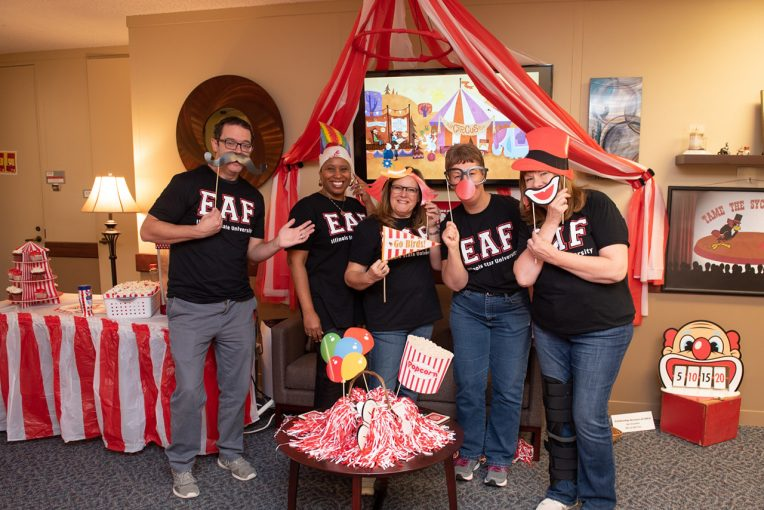 group of people with circus theme decoration
