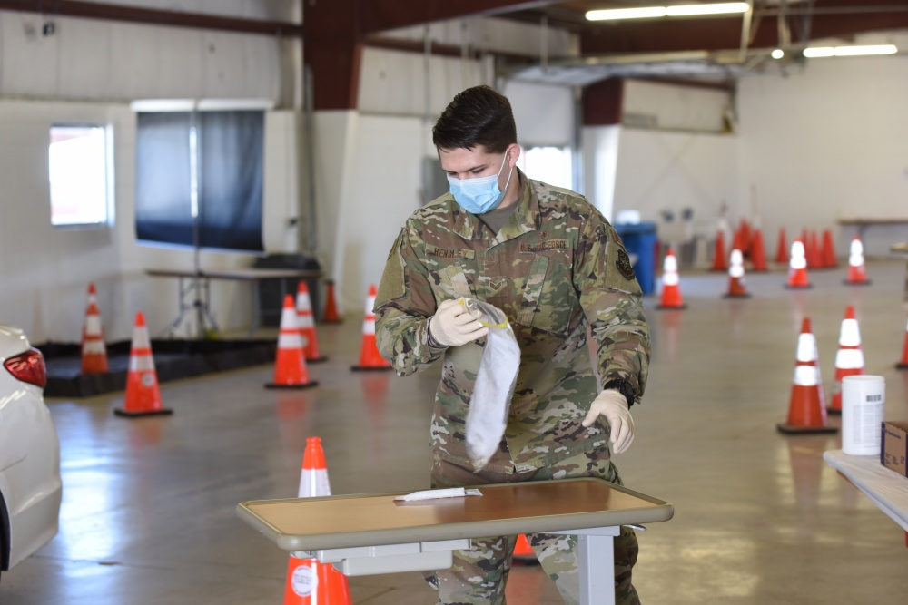 Nicholas Hensley, a medical technician with the 182nd Medical Group, processes a nasal test swab from an individual tested for COVID-19 at the McLean County Fair Grounds test site in April 2020.