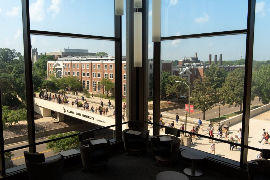 Students crossing the bridge over College Avenue as seen from Milner Library