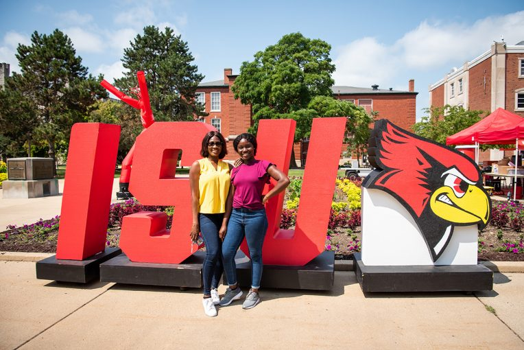 Students standing in front of ISU sign
