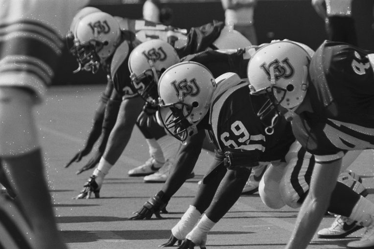 Players lined up in formation on the line of scrimmage