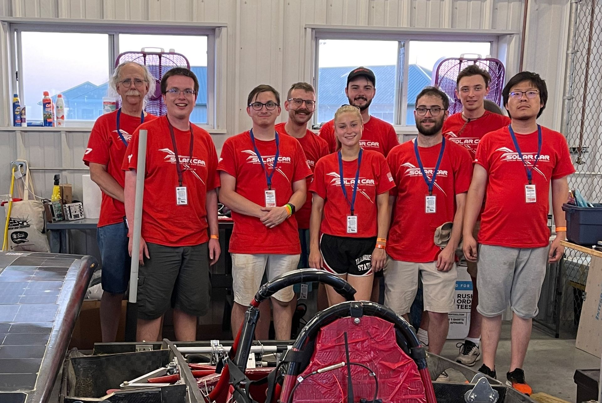 team stands by solar car