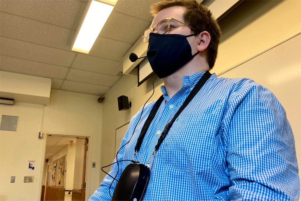 Instructor wearing a personal voice amplifier