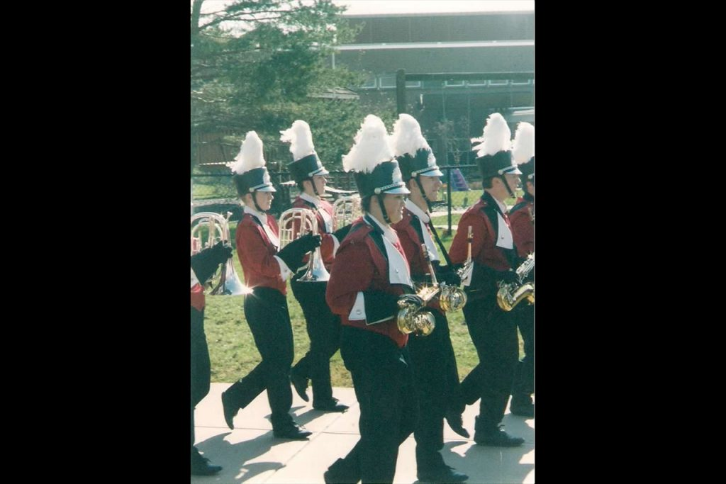 people walking in marching band outfits