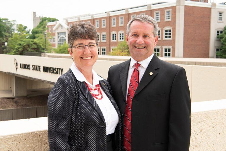 man and woman standing in front of ISU Bridge