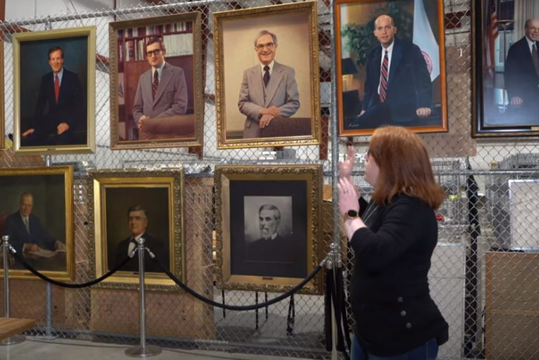woman looking at portraits of presidents
