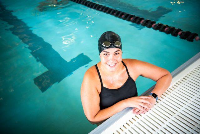 Nursing major Rachel Subrin enjoys some downtime swimming in the Student Fitness Center.