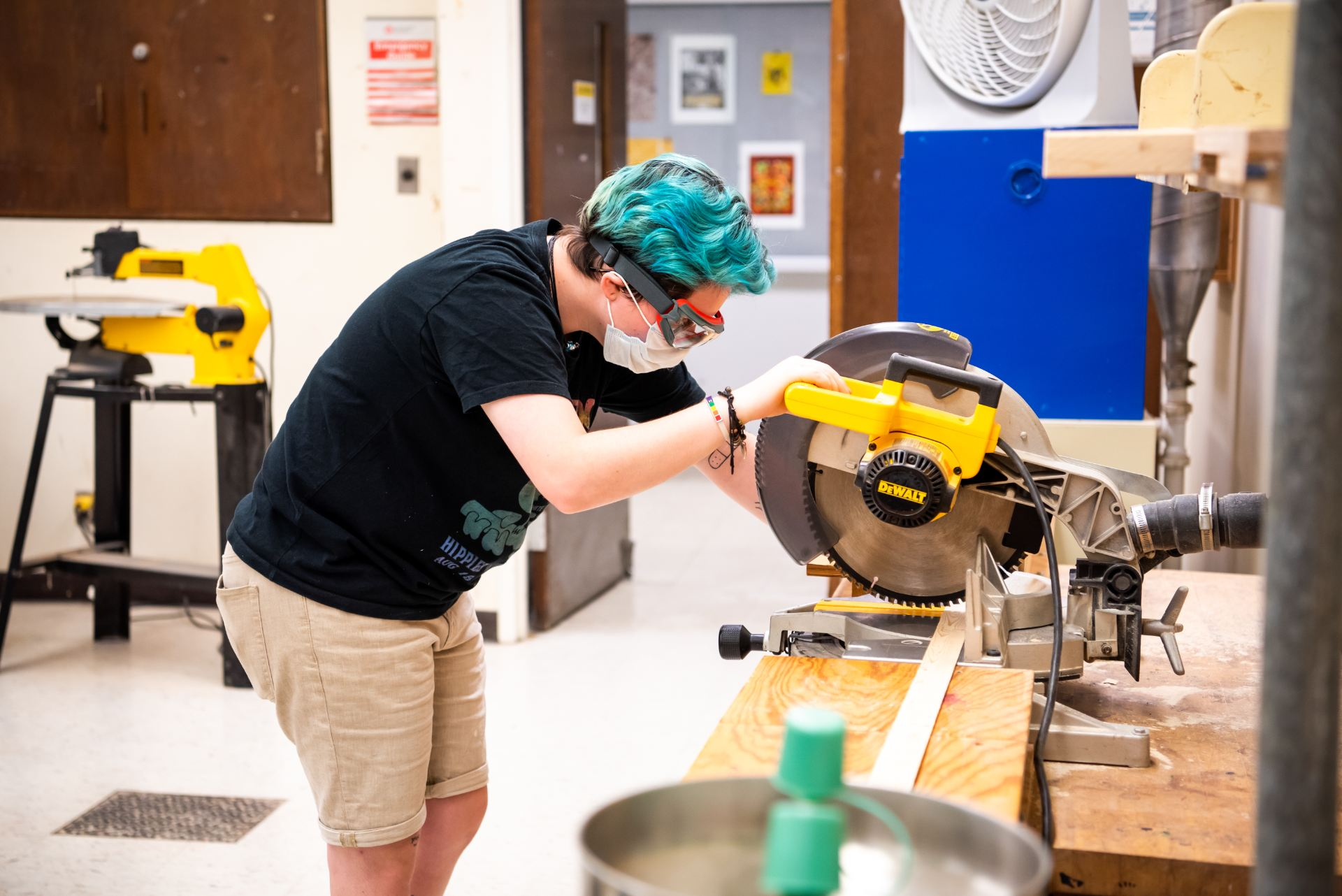 """Studio art major Laney Turner saws wood for their """"Floor to Ceiling"""" project in Professor Gary Justis' Sculpture I class."""