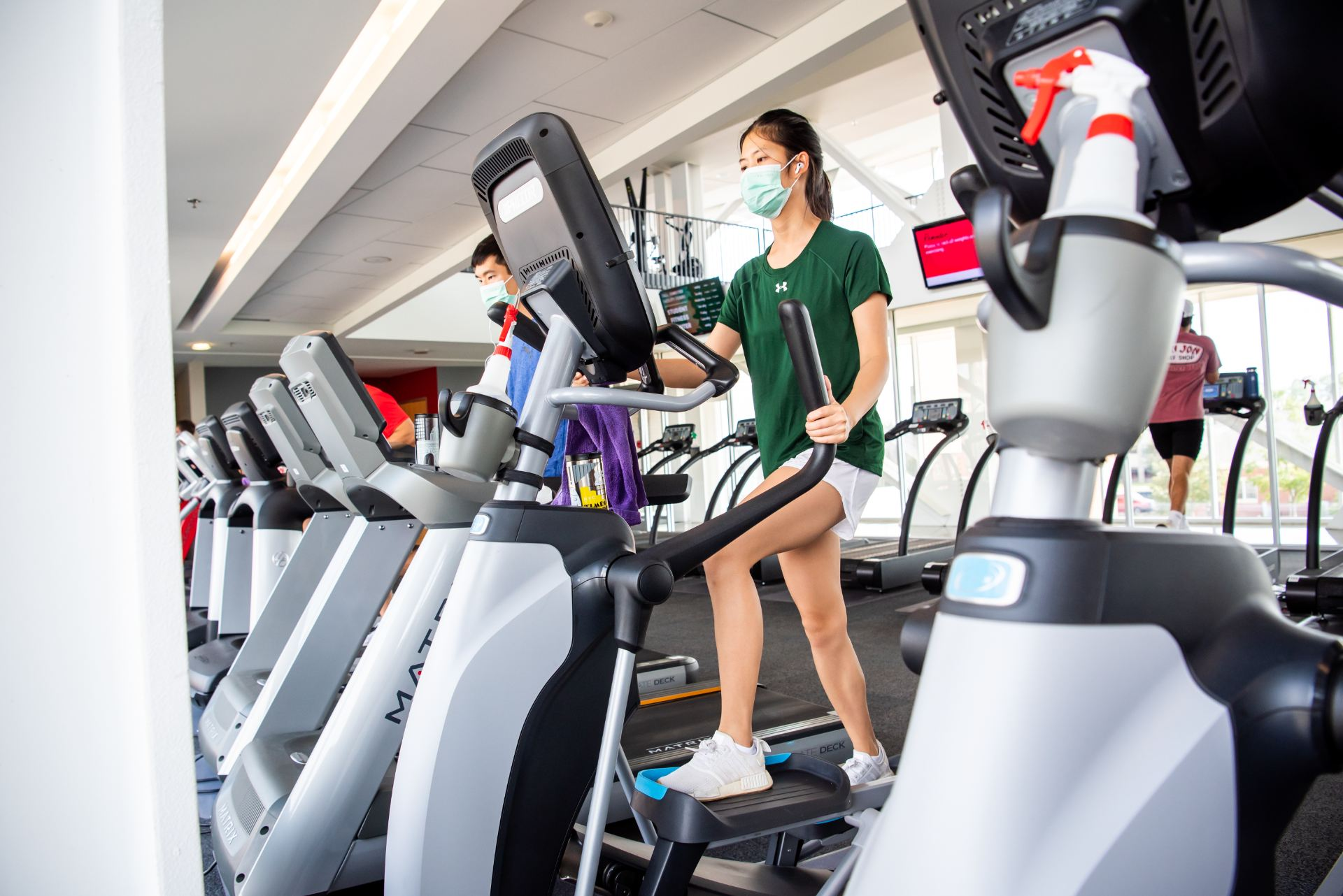 MBA student Pasinee Veerutamasen jogs on a treadmill in the Student Fitness Center.