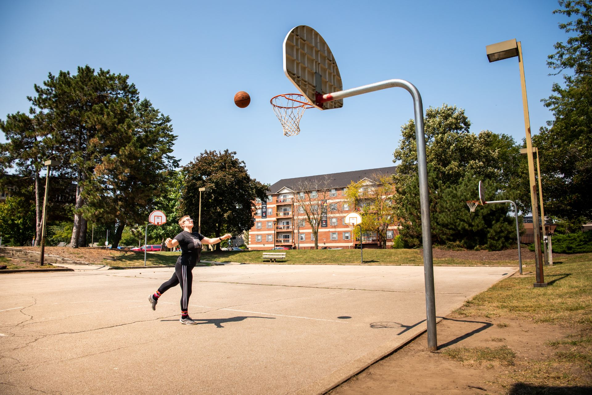Special Education major Xena Tisdale spends some free time shooting hoops outside of Hewett-Manchester.