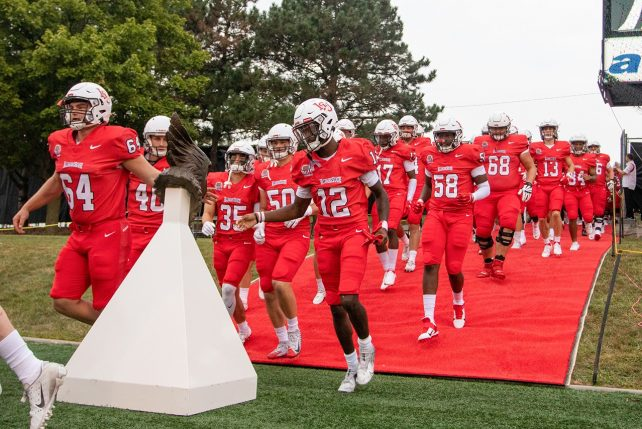 Redbird football team enters the field before opening victory over Butler at Hancock Stadium