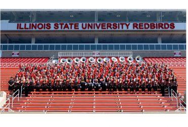 Members of the Big Red Marching Machine pose in Handcock Stadium