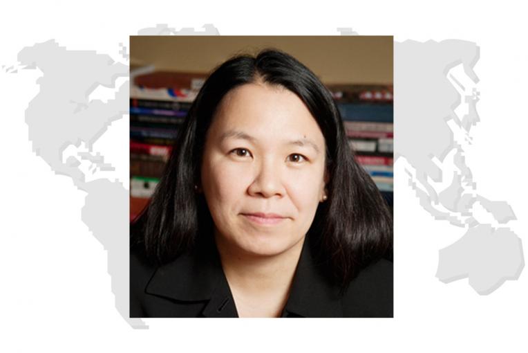 Image of Dr. Wong on stylized world map background