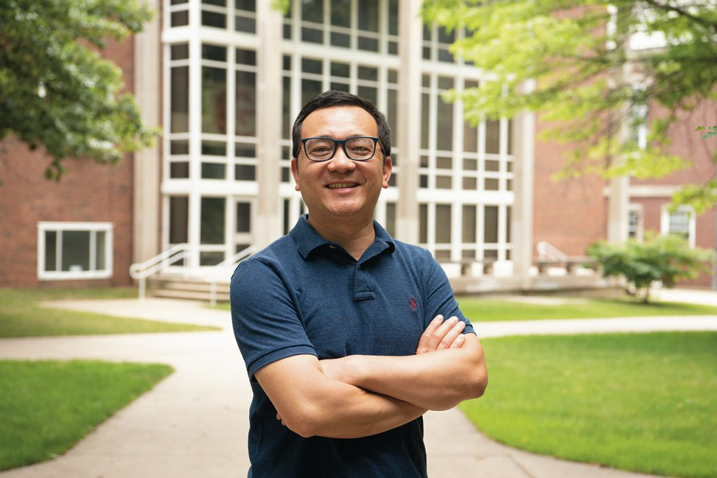 Dr. Shaoen Wu in front of a university building