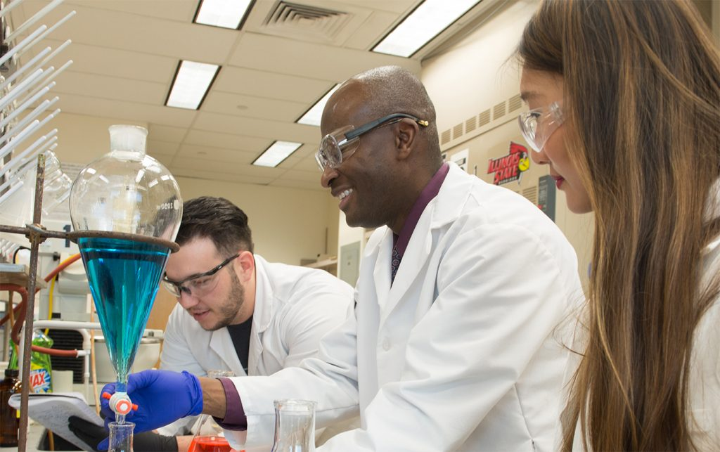 Dr. Shawn Hitchcock with students in his laboratory at Illinois State University.