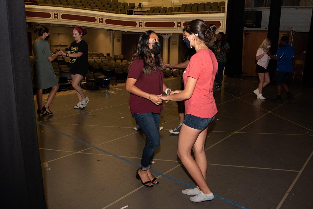 Redbirds en Ritmo members dancing at a club meeting