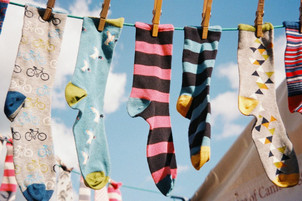 Socks hanging from clothesline