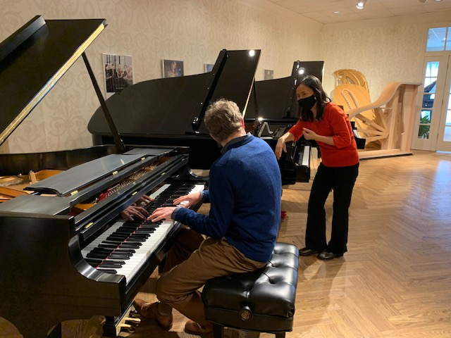 Associate Professors of piano Tuyen Tonnu and Geoffrey Duce at the Steinway Piano Gallery St. Louis in Maryland Heights, Missouri
