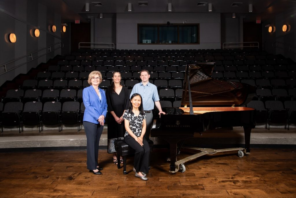 Dean Miller, Interim Director Adriana Ransom and Associate Professors of piano Tuyen Tonnu and Geoffrey Duce with one of the new Steinway concert grand model B pianos, Kemp Recital Hall