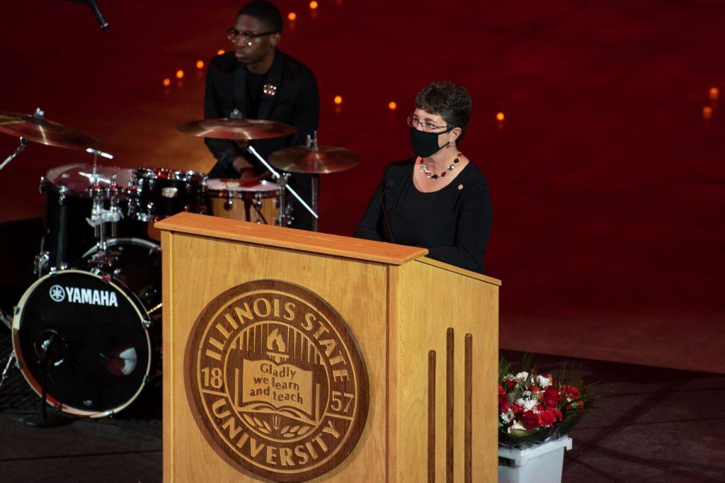 University president speaking at a podium.