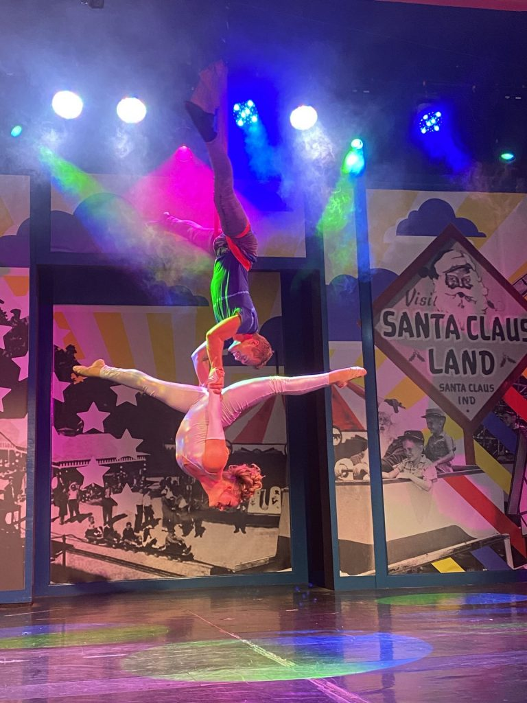 a pair of circus performers doing aerial tricks onstage