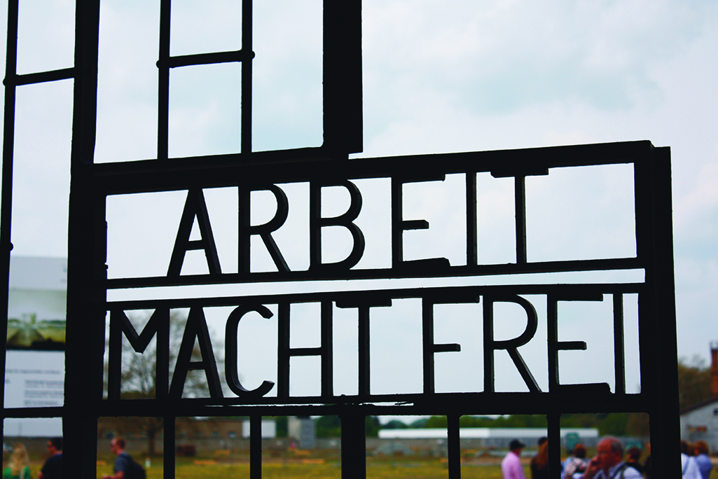 """""""Arbeit macht frei"""" German phrase, """"work sets you free."""" A false promise that those who worked to exhaustion would eventually be released."""
