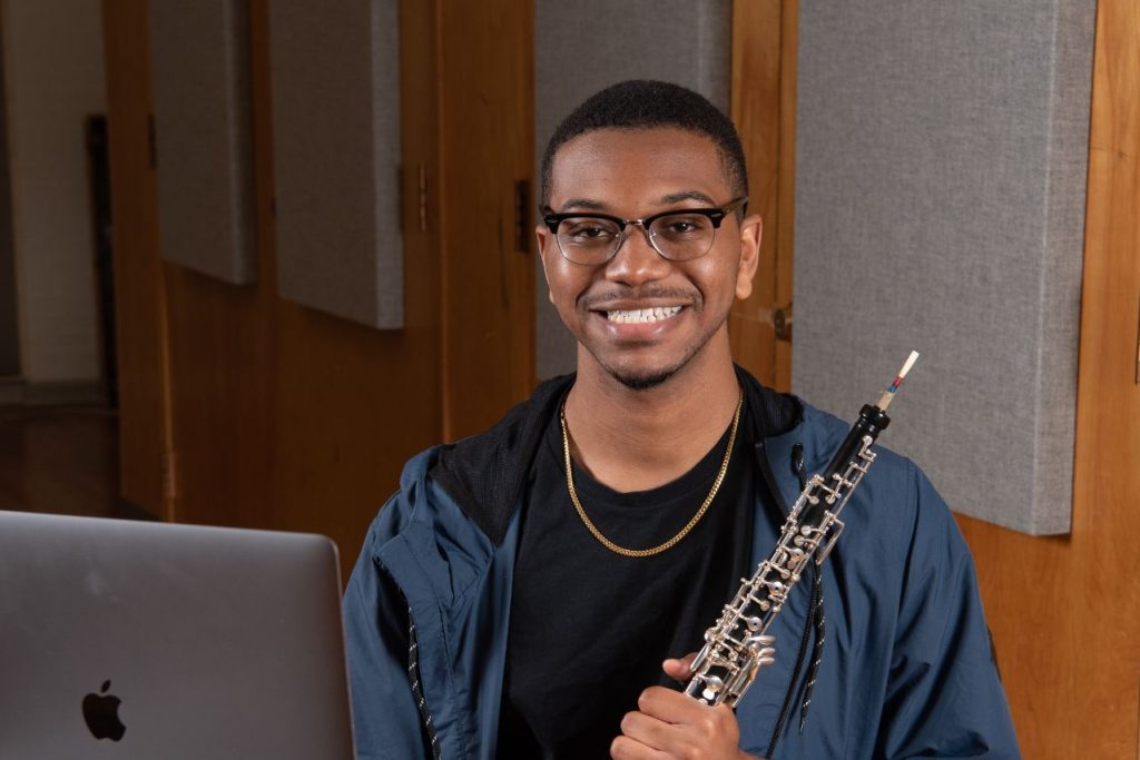 Tyler Bloomfield poses with his oboe.