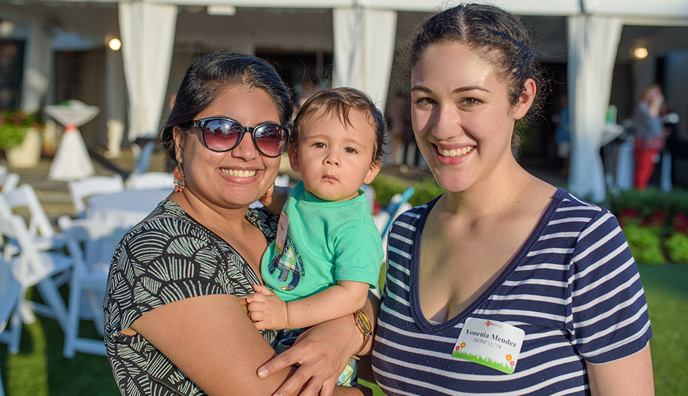 Yessenia Mendez BS'11, MBA'14 (right) and her son chat with Rekha Manohar BS'11, MS'14, MBA'14.