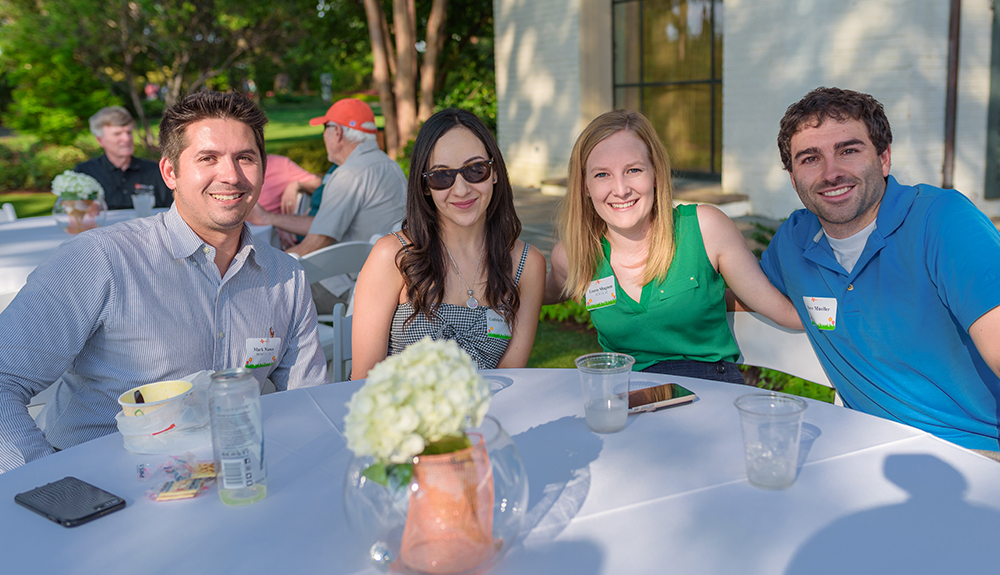 From left: Mark Nunes BS'11, MS'13 and girlfriend Gabriela Ramirez catch up with Laura Shagman BS'11, MSEE'12 and her fiancé, Steve Mueller.