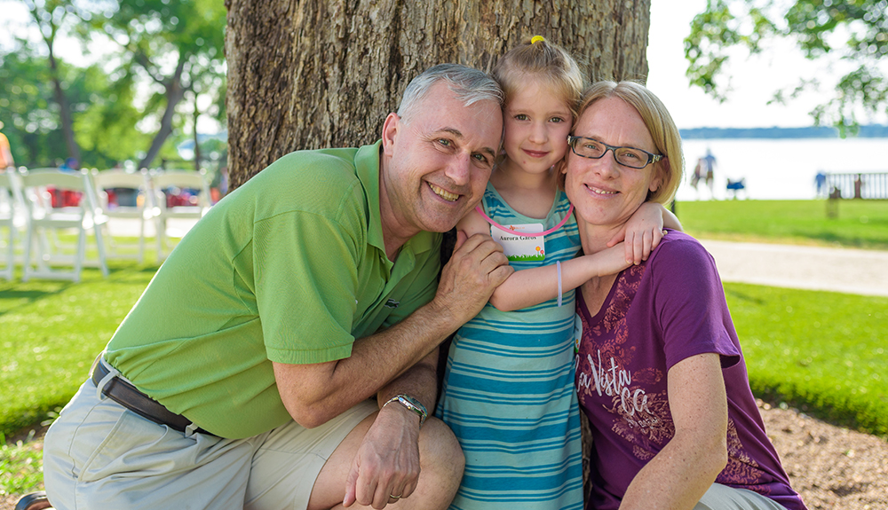 Jako Garos MBA'94 and wife Sharon pose for a family photo with their daughter Aurora to commemorate the event.