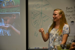 Emily Parker presenting to students