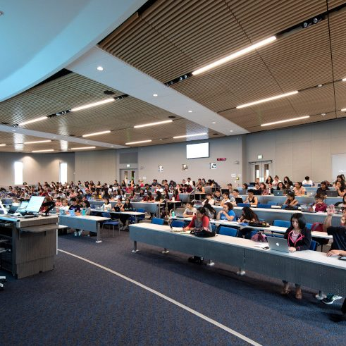 Matthew Mahavongtrakul teaches his molecular biology class in the 200-seat auditorium at the ALP. photo: Steve Zylius/UCI