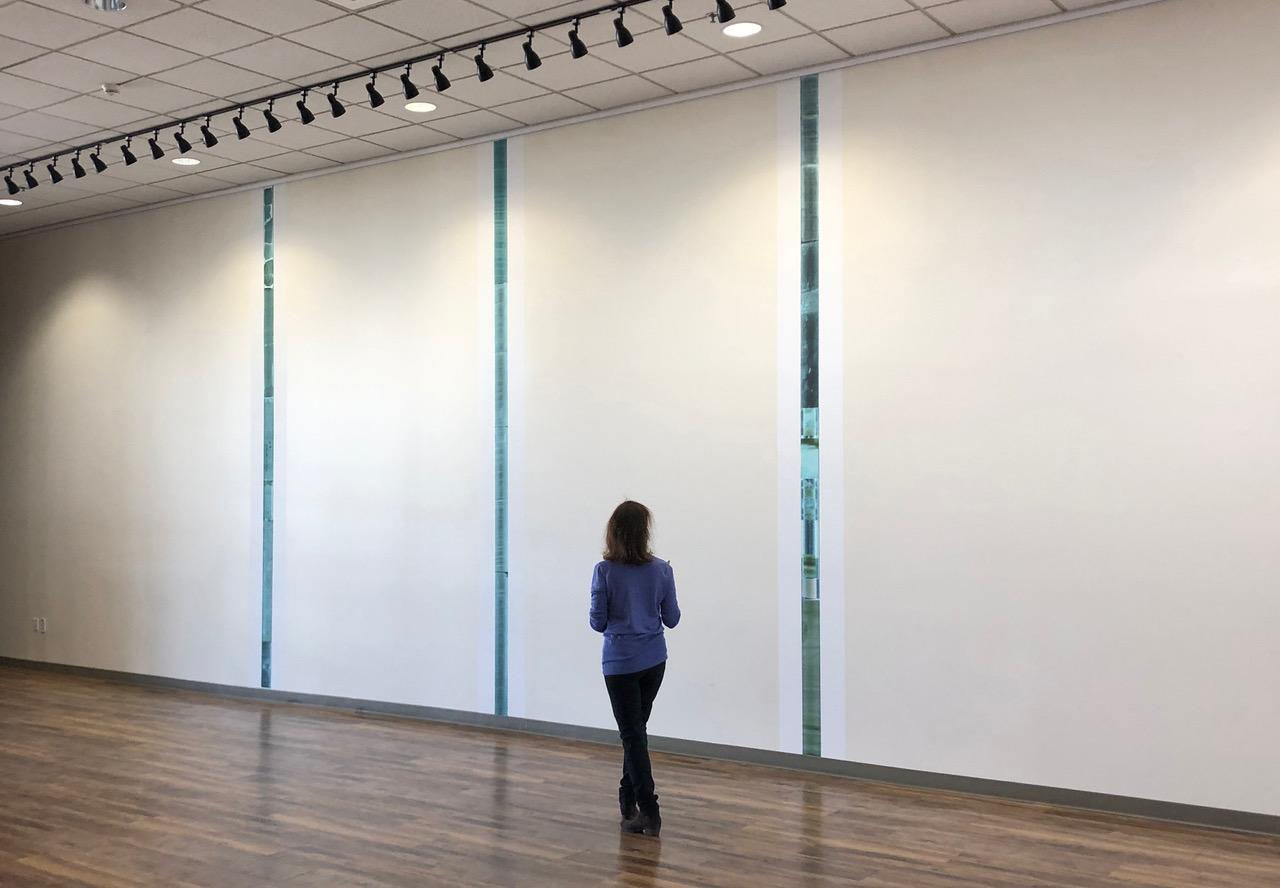 woman walking in gallery