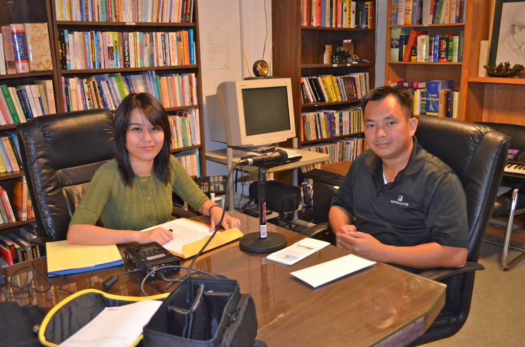 UCI student, Tram Vo, interviewing La Quoc Tam at Vien Dong Daily News