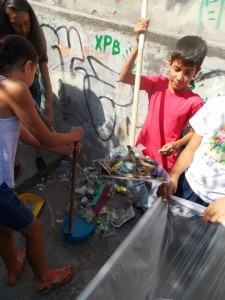 Clean up Day. During several occasions children cleaned the trash in the alley.