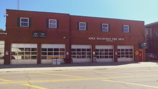 Red brick building with the words Apex Volunteer Fire Dept