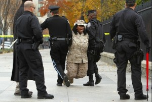 Former Marine Cpl. Evelyn Thomas is arrested outside the White House in November 2010 while protesting the don't ask, don't tell policy. Photo: Alex Wong/Getty Images