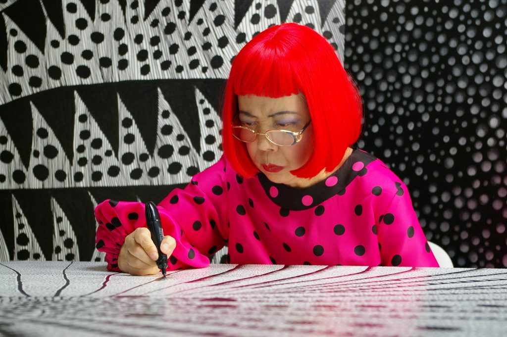 Artist Yayoi Kusama drawing in Kusama - Infinity. © Tokyo Lee Productions, Inc. Courtesy of Magnolia Pictures.