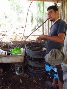 Javier, the owner of Villas, explains the compost heater.