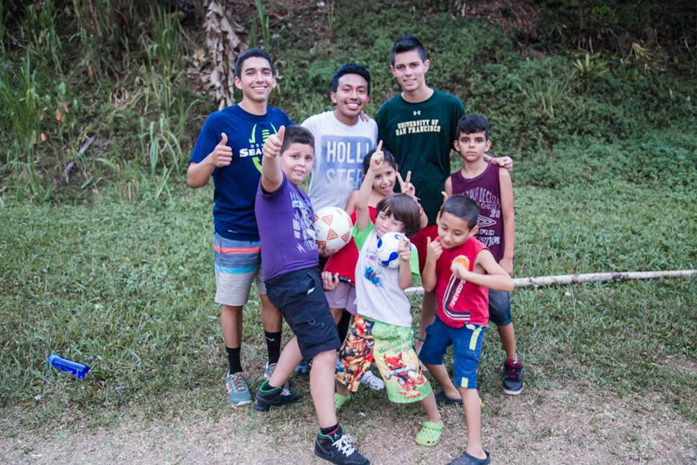 The author, Erick, and local Tico kids pose with soccer equipment.